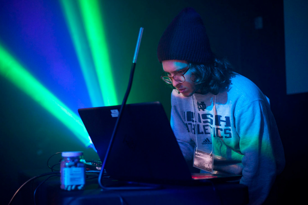 An AET student participates in the department's VJ Battle, which combines lighting design timed to original compositions. Photo by Lawrence Peart.