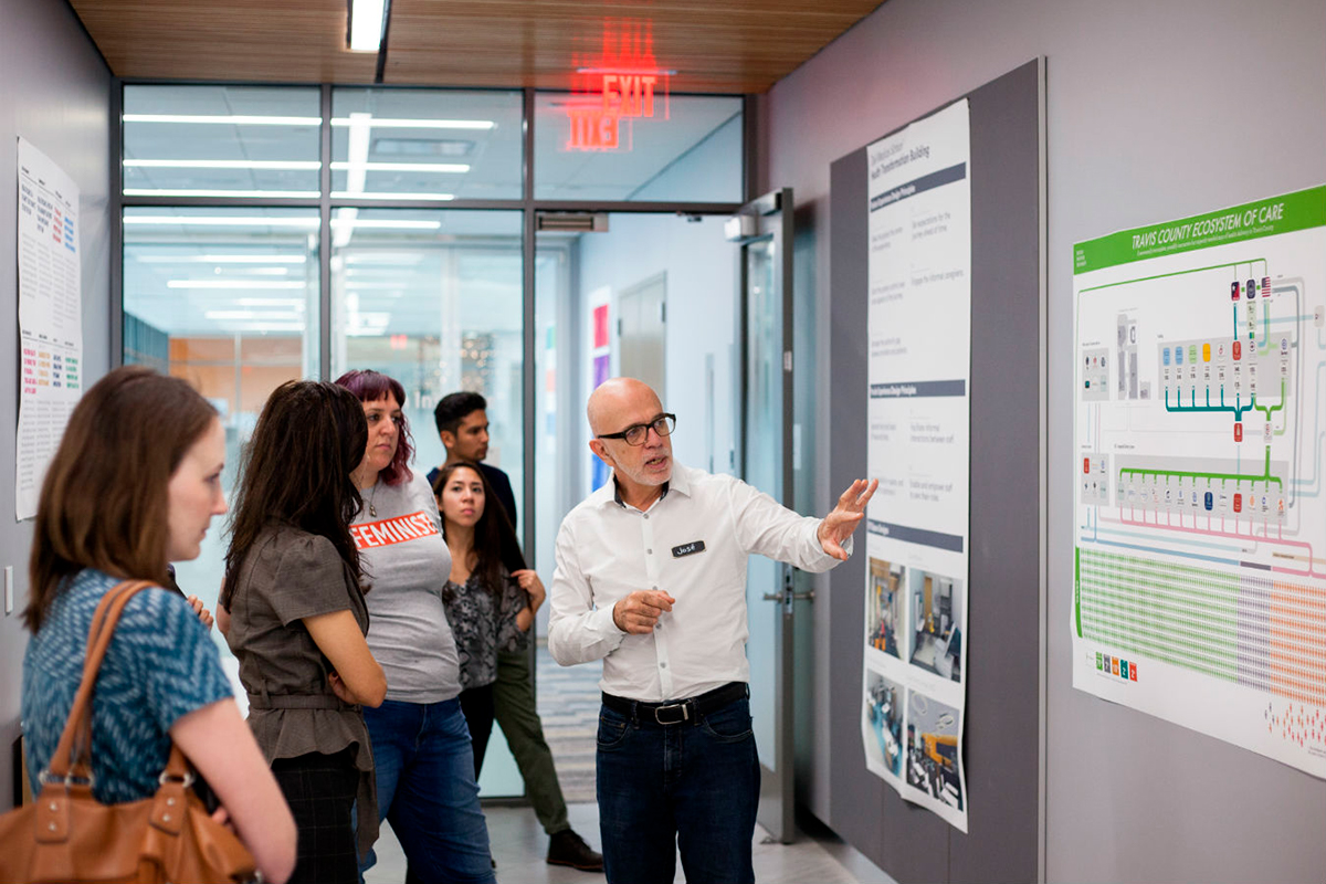 José Colucci gives a tour of the Design Institute for Health offices to members of the public during an open studio tour. Photo by Lawrence Peart.