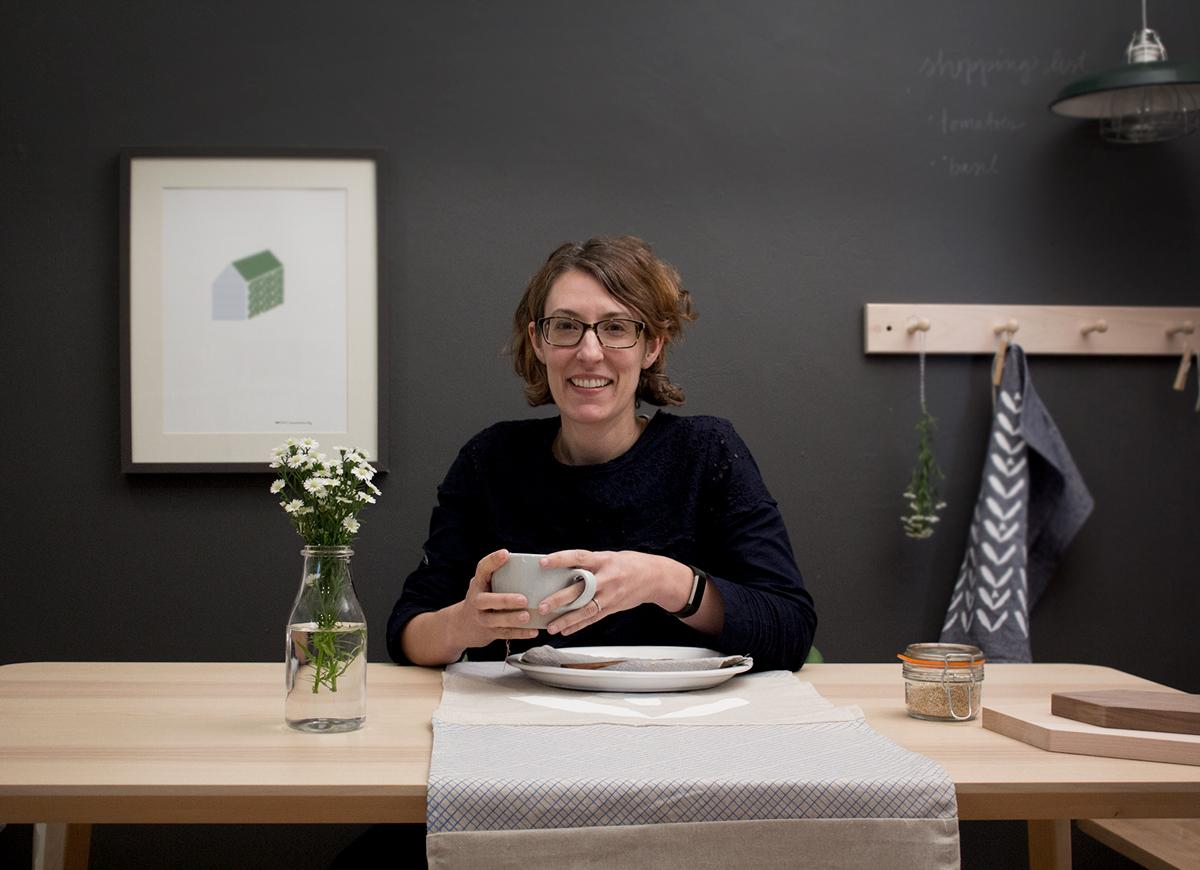 Alyson Beaton at a table with coffee