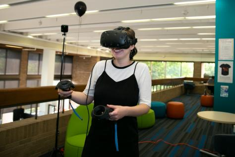 SDCT intern Michaela Newman tries virtual reality for the first time