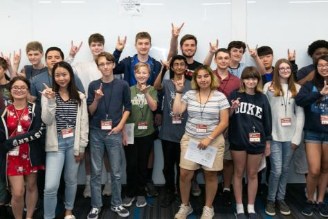 the 2019 SDCTx Game Design Summer Institute cohort of high school students raise the