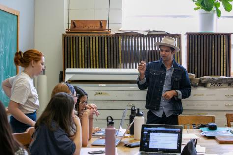 Professor Jason Wilkins teaching students in the Design Lab during class