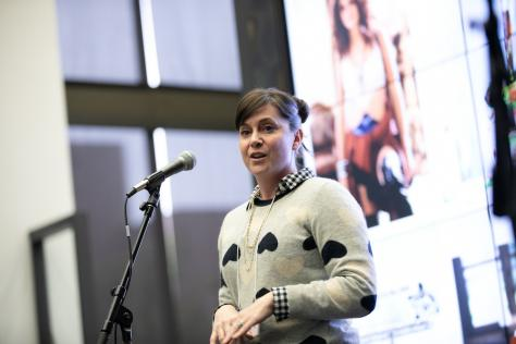 Shawna Murland, Associate Director of User Experience (UX) and Strategic Innovation at AT&T, speaking at the Center for Integrated Design's Design + Impact event in November 2019