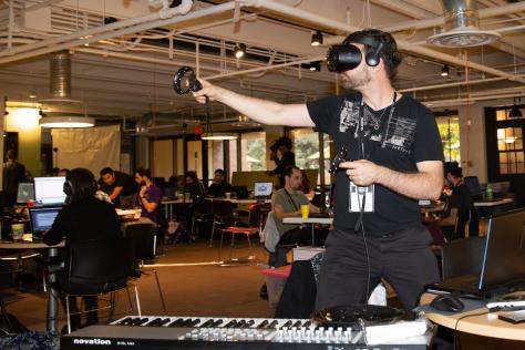 an arts and entertainment technologies student tests virtual reality equipment at the 2019 VR Austin game jam