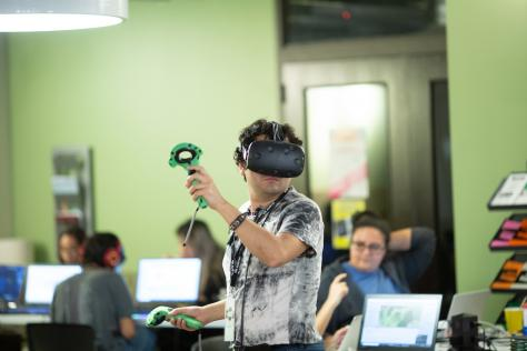 game design student testing virtual reality at 2019 VR Austin Game Jam at the School of Design and Creative Technologies