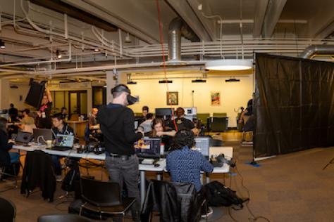 Panoramic view of the VR Austin Game Jam 2019, held on the first floor of the School of Design and Creative Technologies at the College of Fine Arts