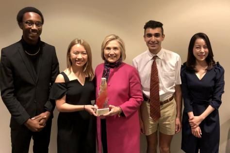 Some of the In The Arena Award design team with recipient Senator Hillary Clinton