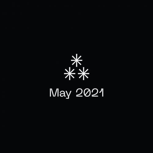 """white text that reads """"May 2021"""" under a cluster of three white asterisks against a black background"""
