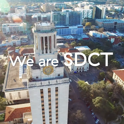 "Aerial shot of the UT Tower with text overlay that reads ""We are SDCT"""