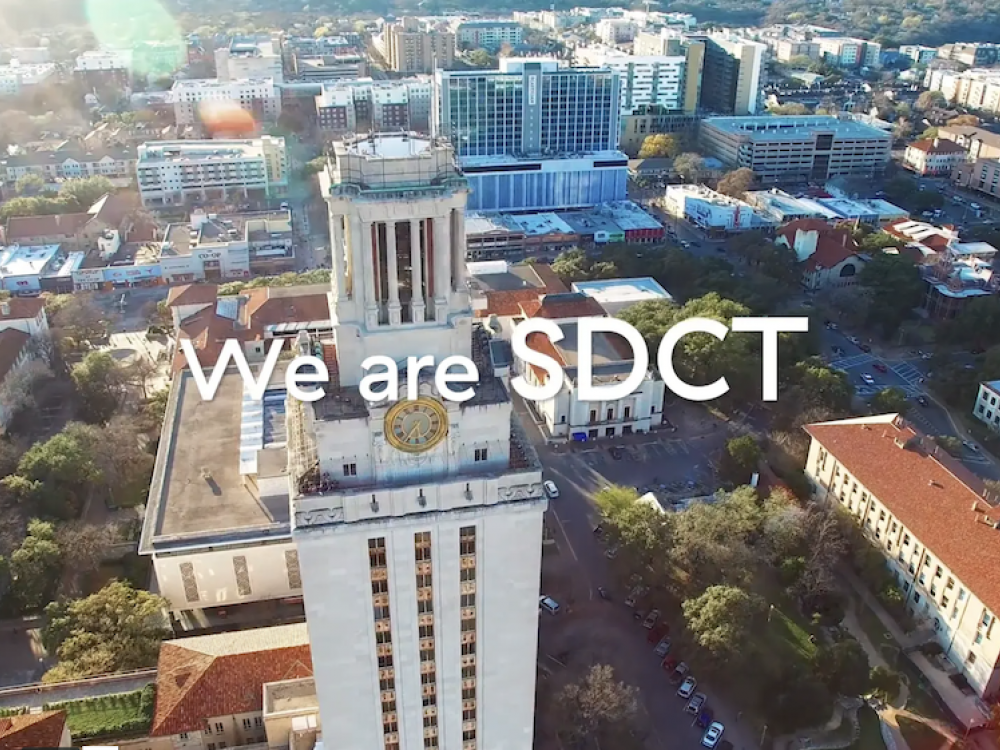 """Aerial shot of the UT Tower with text overlay that reads """"We are SDCT"""""""