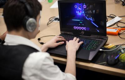 Student working on a game at a computer