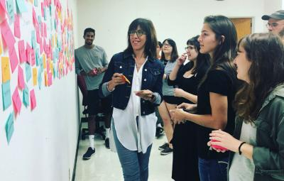 Doreen Lorenzo works with students in a class offered by the Center for integrated Design. Photo by Michelle Harris.