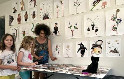 Arts and Entertainment Technologies faculty member Yuliya Lanina creating artwork with her two daughters at home while quarantining during COVID-19