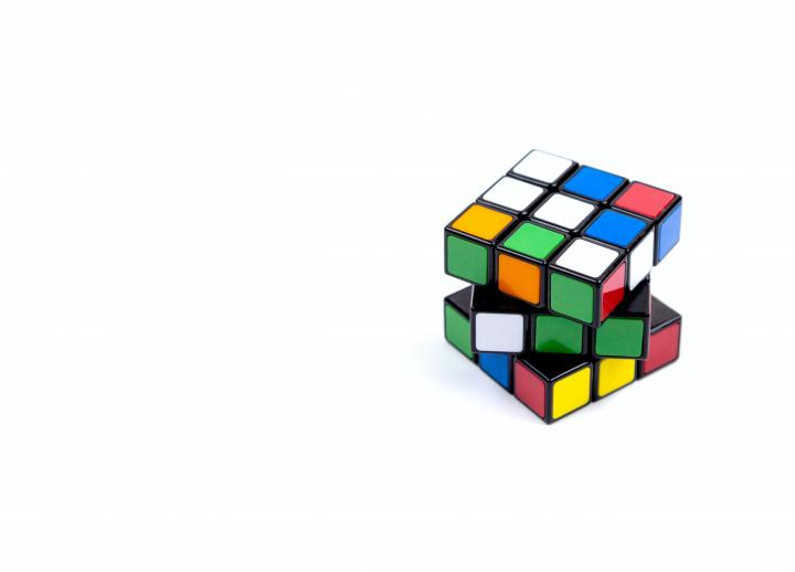 twisted Rubix cube against white background