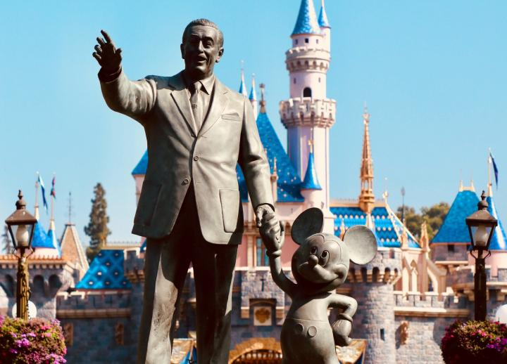 photo of statue in front of Disneyland of Walt Disney holding Mickey Mouse's hand