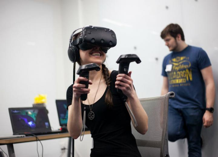 A student demos a VR game at the AET Showcase. Photo by Lawrence Peart.