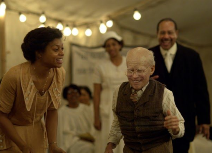still from movie Benjamin Button with main character and smiling woman