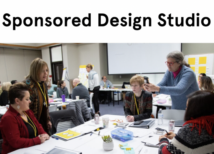 participants sitting around a table at an SDCT Executive and Extended Education customized design challenge studio at the University of Texas at Austin
