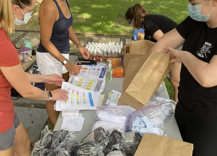 researchers from the Design Institute for Health hand out COVID-19 safety kits to community members from affordable housing in East Austin